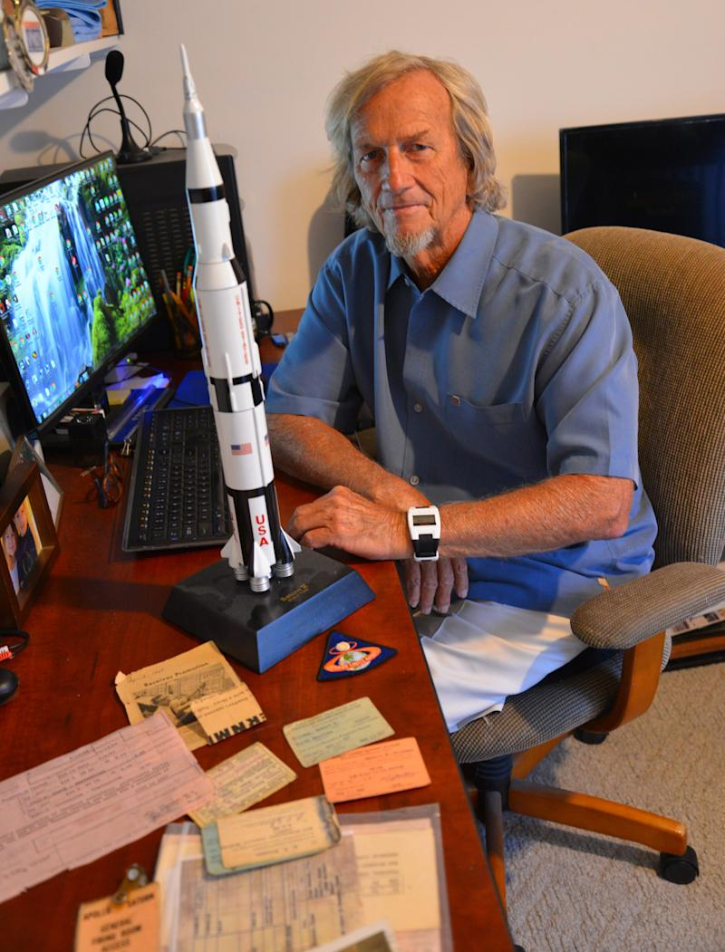 Bob Freeman in the office of his Melbourne home, with a Saturn V model on his desk. He worked on the Apollo program from 1967-69.