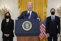 President Joe Biden speaks about the evacuation of American citizens, their families, SIV applicants and vulnerable Afghans in the East Room of the White House, Friday, Aug. 20, 2021, in Washington. Vice President Kamala Harris, left, and Secretary of State Antony Blinken listen. (AP Photo/Manuel Balce Ceneta)