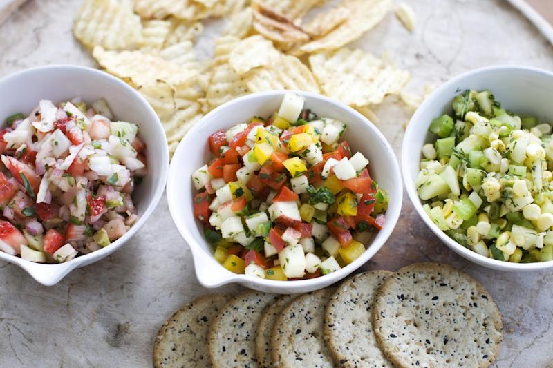 In this image taken on June 3, 2013, from left, strawberry-fennel salsa, apple-pepper salsa, and cucumber-corn salsa are shown served in bowls in Concord, N.H. (AP Photo/Matthew Mead)