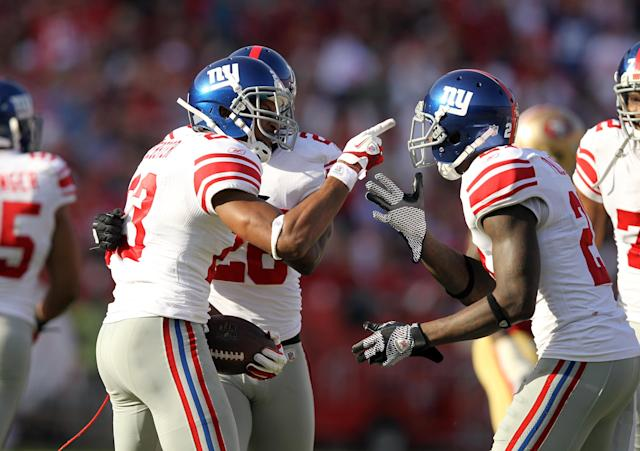 SAN FRANCISCO, CA - NOVEMBER 13: Corey Webster #23 of the New York Giants (L) celebrates with teammates after he intercepted a pass during their game against the San Francisco 49ers at Candlestick Park on November 13, 2011 in San Francisco, California. (Photo by Ezra Shaw/Getty Images)