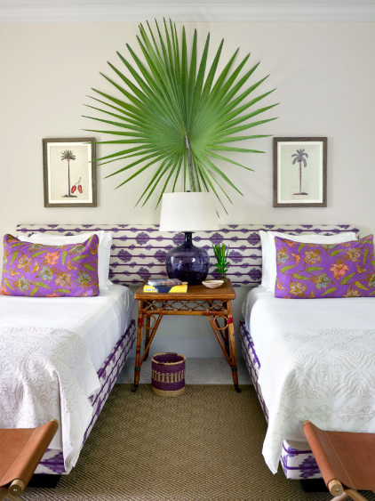<p>A vibrant palm leaf acts as a piece of artwork in this beachy bohemian room. </p>