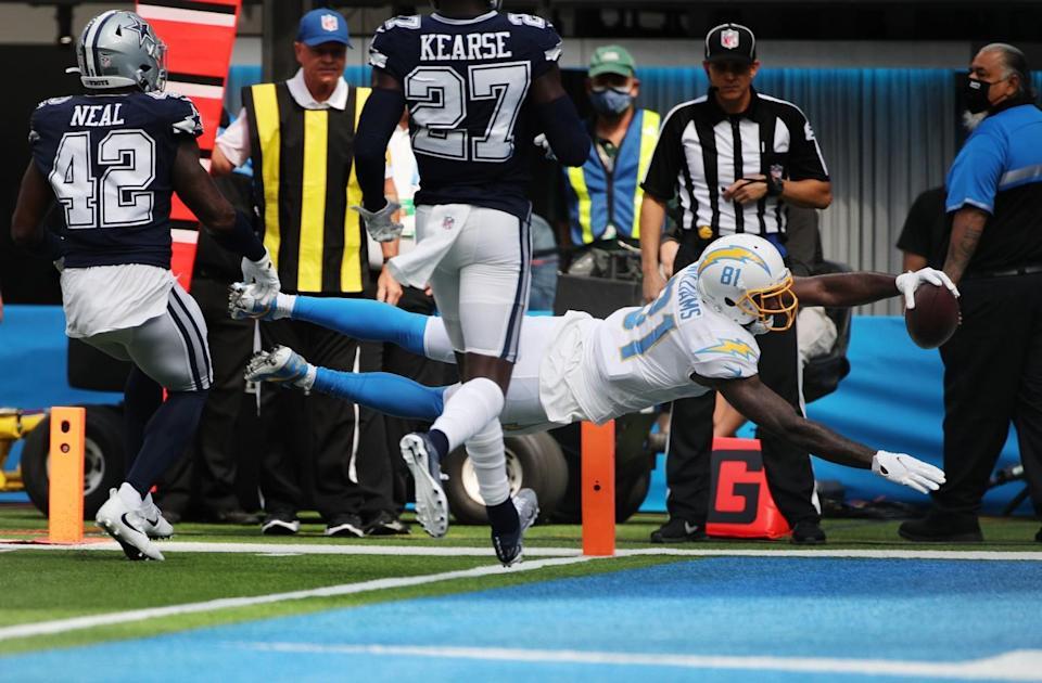 Chargers wide receiver Mike Williams dives into the end zone to score on a 12-yard touchdown pass from Justin Herbert.