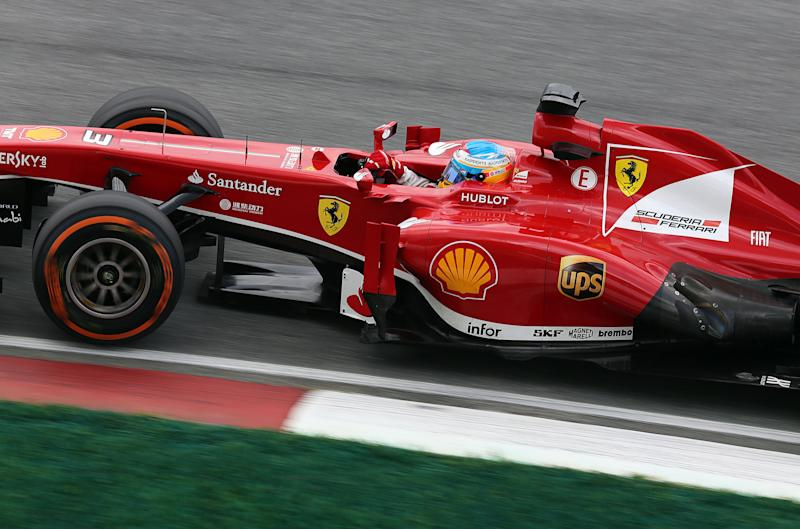Ferrari driver Fernando Alonso of Spain drives his car during the third free practices for the Malaysian Formula One Grand Prix at Sepang, Malaysia, Saturday, March 23, 2013. (AP Photo/Raymond Ho)