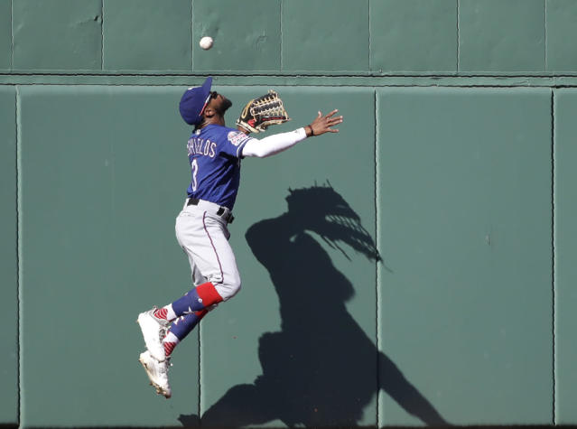 Texas Rangers center fielder Delino DeShields cannot make the catch on an RBI-triple off the wall by Boston Red Sox's Andrew Benintendi in the third inning of a baseball game at Fenway Park, Wednesday, June 12, 2019, in Boston. (AP Photo/Elise Amendola)
