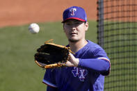 Texas Rangers pitcher Kohei Arihara catches a ball during baseball spring training Wednesday, Feb. 24, 2021, in Surprise, Ariz. (AP Photo/Charlie Riedel)