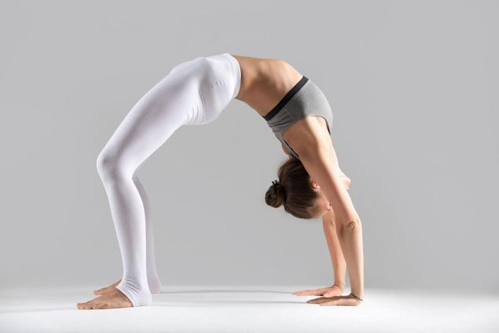 Dhanurasana stretches your stomach, chest, back, and neck.