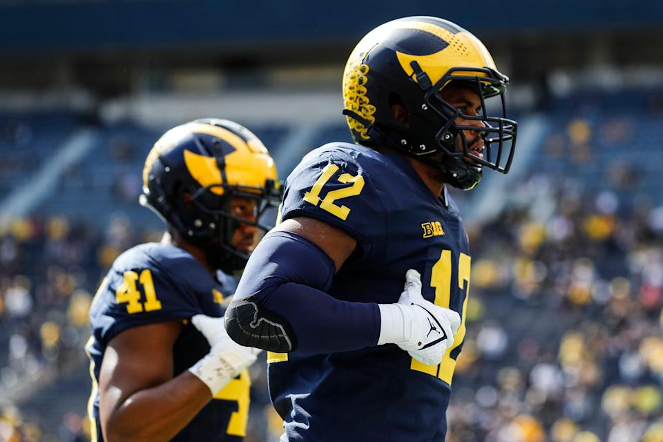 Michigan linebacker Josh Ross warms up before the Rutgers game at Michigan Stadium in Ann Arbor on Saturday, Sept. 25, 2021.