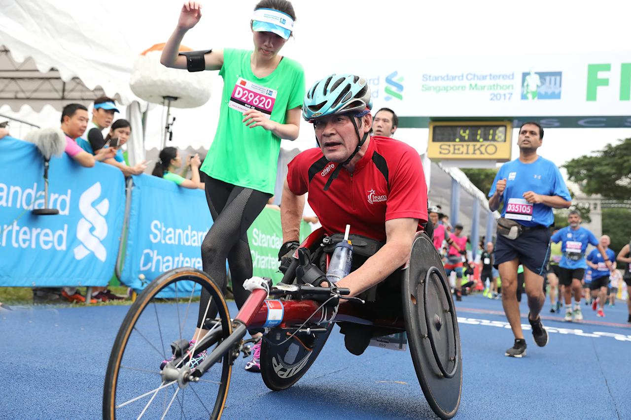 <p>7th ASEAN Para Games para-athlete Mr Lai Pak Lok Jack at the finishing upon completing the 10km wheelchair race.<br /> Photo: Standard Chartered Singapore Marathon 2017 </p>