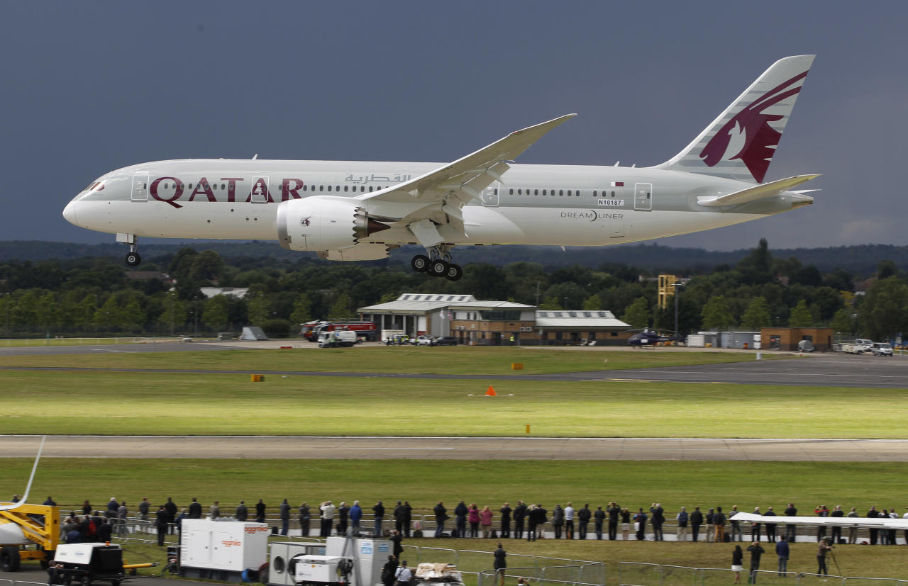 <p> FILE- in this file photo dated Wednesday, July 11, 2012, onlookers watch as a Qatar Airways Boeing 787 Dreamliner lands during an aerial display at the Farnborough International Airshow, in Farnborough, England. The state-owned Commercial Aircraft Corp. of China, known as Comac, announced plans this week at Farnborough airshow 2016, for a wide-body aircraft to be built with state-owned Russian maker United Aircraft Corporation, striking at the heart of the market leaders Airbus and Boeing. (AP Photo/Lefteris Pitarakis, FILE) </p>