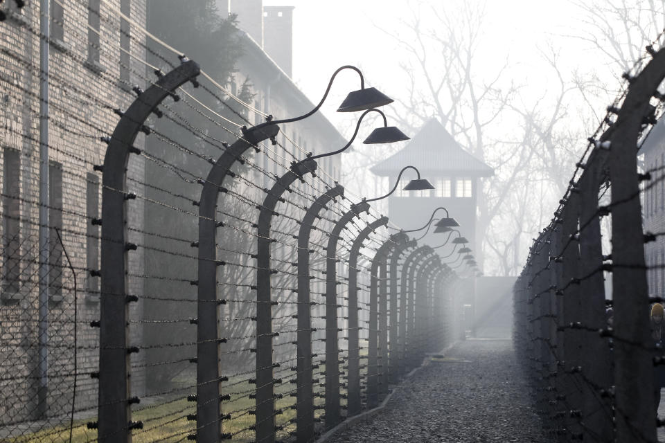 People arrive for commemorations at the Auschwitz Nazi death camp in Oswiecim, Poland, Monday, Jan. 27, 2020. Survivors of the Auschwitz-Birkenau death camp gathered for commemorations marking the 75th anniversary of the Soviet army's liberation of the camp, using the testimony of survivors to warn about the signs of rising anti-Semitism and hatred in the world today.(AP Photo/Czarek Sokolowski)
