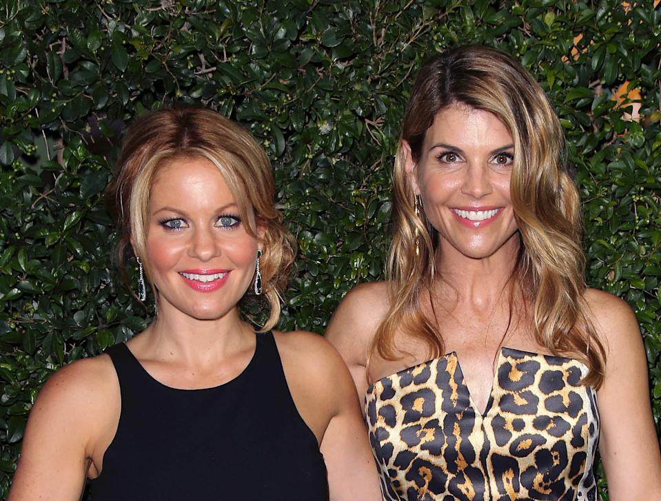 """""""Fuller House"""" stars Candace Cameron Bure (L) and Lori Loughlin pictured together in 2015. (Photo: David Livingston/Getty Images)"""