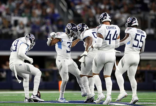 Tennessee safety Kevin Byard, center, was fined $10,026 for celebrating an interception on the Dallas Cowboys' star. (Getty Images)