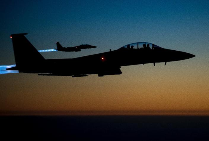 A pair of US F-15E aircraft fly over Iraq after conducting air strikes in Syria in 2014, shown in this US Air Force picture (AFP Photo/Senior Airman Matthew Bruch)