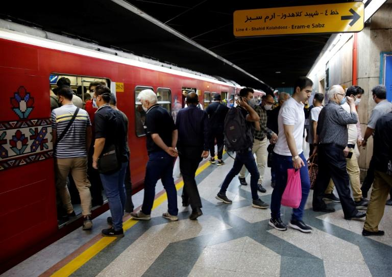 Most but by no means all passengers on the Tehran metro have been wearing face masks against the coronavirus, something President Hassan Rouhani wants to change