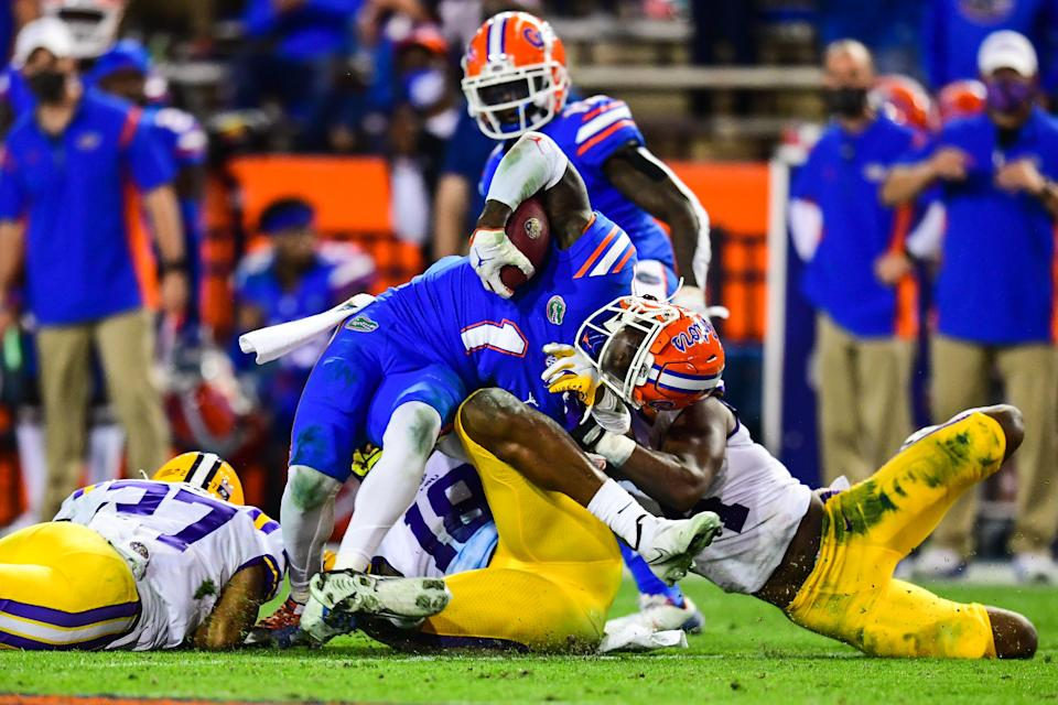 GAINESVILLE, FL - DECEMBER 12: Eli Ricks #1 of the LSU Tigers makes a tackle against the Florida Gators at Ben Hill Griffin Stadium on December 12, 2020 in Gainesville, Florida. (Photo by Gus Stark/Collegiate Images/Getty Images)