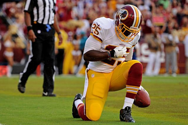 LANDOVER, MD - AUGUST 24: Running back Keiland Williams #25 of the Washington Redskins celebrates after rushing for a touchdown against the Buffalo Bills in the fourth quarter during a preseason game at FedExField on August 24, 2013 in Landover, Maryland. (Photo by Patrick Smith/Getty Images)