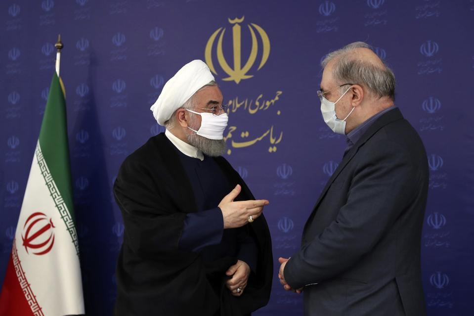 FILE - In this July 4, 2020, file photo released by the official website of the office of the Iranian Presidency, President Hassan Rouhani, left, talks with his Minister of Health and Medical Education Saeed Namaki during a meeting in Tehran, Iran. As coronavirus infections reached new heights in Iran, overwhelming its hospitals and driving up its death toll, the country's health minister gave a rare speech criticizing his own government's refusal to enforce basic health measures. (Iranian Presidency Office via AP, File)