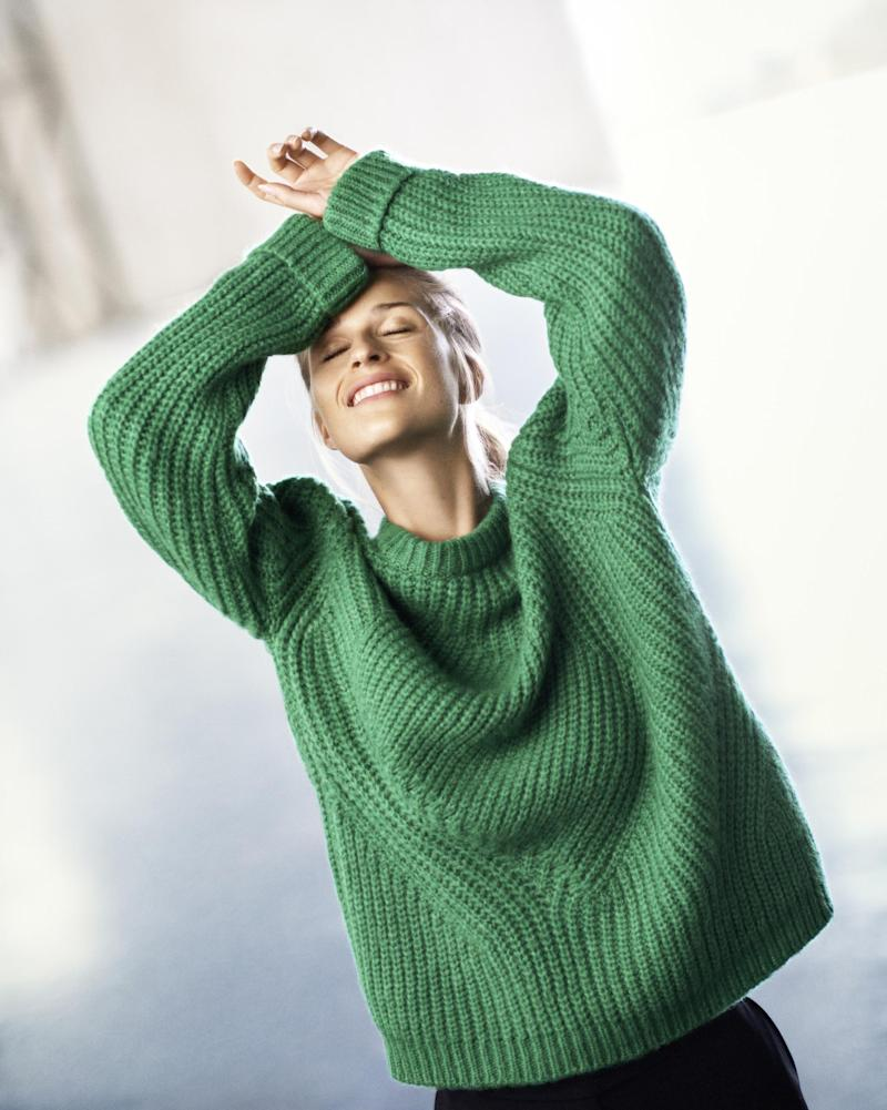 Jumper: demand for Next's warmer clothes amid cold weather helped boost sales: Next