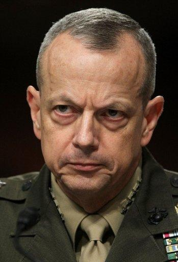 """US General John Allen -- who is in charge of NATO's 130,000 troops in Afghanistan -- testifies before a Senate Committee in March 2012. Allen has offered to help local security forces track and capture the men involved in what he called """"an atrocity of unspeakable cruelty"""". A manhunt is under way for Taliban militants who publicly executed a woman accused of adultery"""