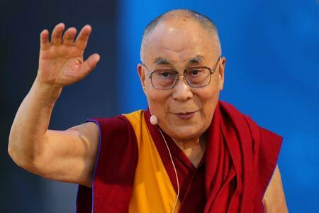 The Dalai Lama waves as he leaves after speaking to thousands at the UC San Diego campus in San Diego