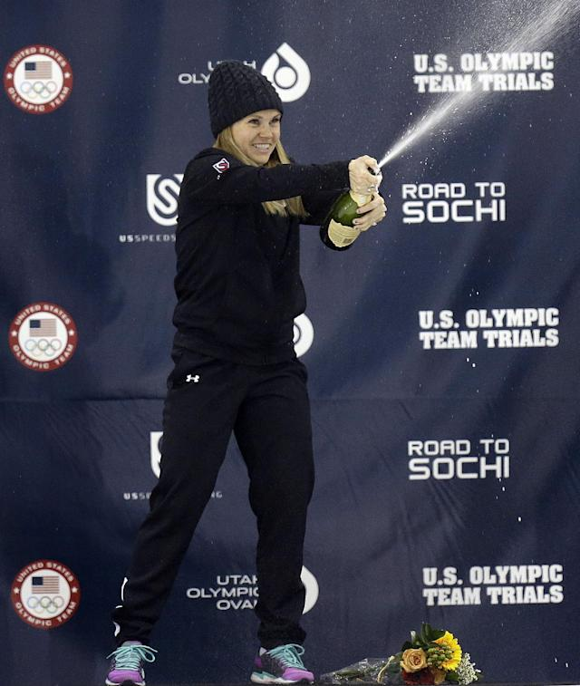 First-place finisher Jessica Smith celebrates on the podium after the women's 500 meters during the U.S. Olympic short track speedskating trials on Saturday, Jan. 4, 2014, in Kearns, Utah. (AP Photo/Rick Bowmer)
