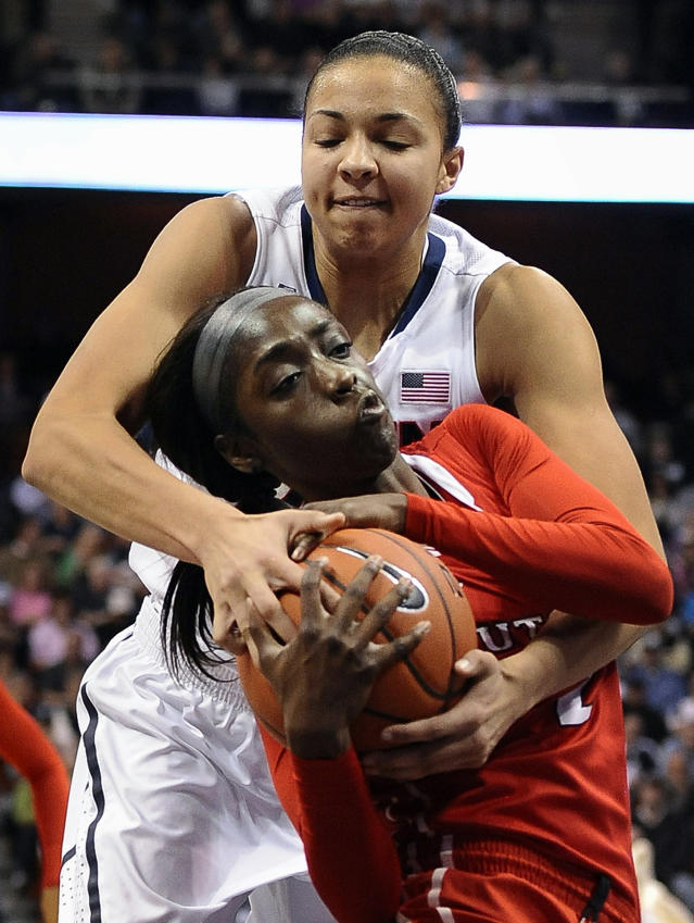 Connecticut's Kiah Stokes, top, pressures Rutgers' Kahleah Copper, bottom, during the second half of an NCAA college basketball game in the semifinals of the American Athletic Conference women's tournament on Sunday, March 9, 2014, in Uncasville, Conn. Connecticut won 83-57. (AP Photo/Jessica Hill)