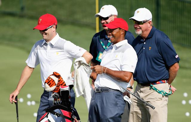 DUBLIN, OH - OCTOBER 01: Zach Johnson and Tiger Woods of the U.S. Team wait with their caddies on the range during a practice round prior to the start of The Presidents Cup at the Muirfield Village Golf Club on October 1, 2013 in Dublin, Ohio. (Photo by Andy Lyons/Getty Images)