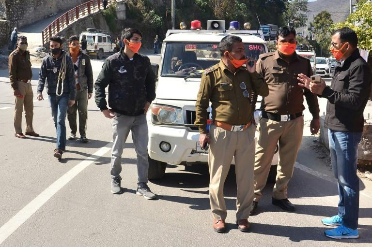 Police personnel prepare in Srinagar of Uttarakhand state on February 7, 2021 after a glacier broke off in Chamoli district causing flash floods in the Dhauli Ganga river