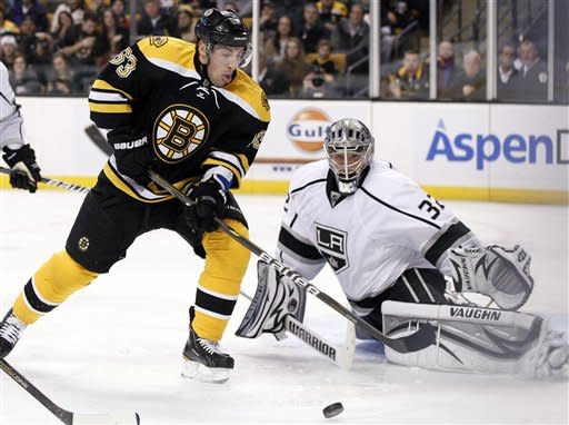 Boston Bruins left wing Brad Marchand (63) tries to get position for a shot against Los Angeles Kings goalie Jonathan Quick (32) in the second period of an NHL hockey game in Boston Tuesday, Dec. 13, 2011. (AP Photo/Elise Amendola)