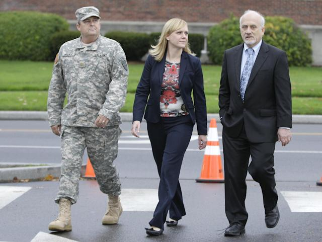 Emma Scanlan, center, the civilian defense attorney for U.S. Army Staff Sgt. Robert Bales, walks Tuesday Nov. 13, 2012, with with Bales' military defense attorney, Maj. Gregory Malson, left, and attorney Lance Rosen, right, on Joint Base Lewis McChord in Washington state, where a preliminary hearing ended Tuesday for Bales, who is accused of 16 counts of premeditated murder and six counts of attempted murder for a pre-dawn attack on two villages in Kandahar Province in Afghanistan last March. (AP Photo/Ted S. Warren)