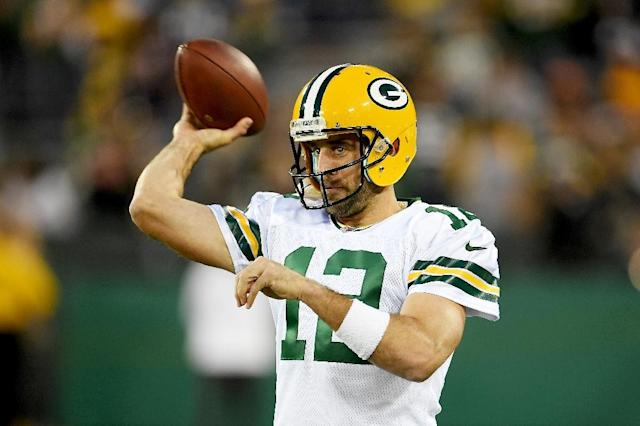 Aaron Rodgers of the Green Bay Packers warms up ahead of their NFL game against the Chicago Bears, at Lambeau Field in Green Bay, Wisconsin, on September 28, 2017 (AFP Photo/Stacy Revere)