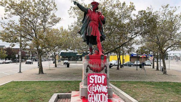 PHOTO: A sign reading 'stop celebrating genocide' sits at the base of a statue of Christopher Columbus on Oct. 14, 2019, in Providence, R.I. (Michelle R. Smith/AP)