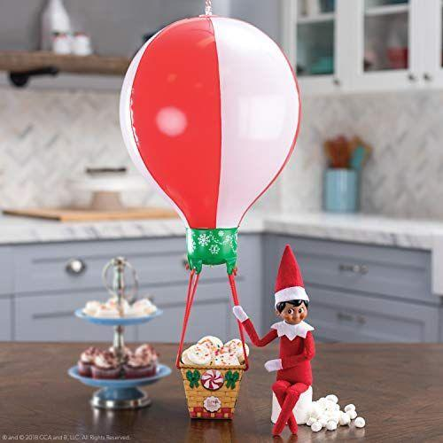 """<p><strong>The Elf on the Shelf</strong></p><p>amazon.com</p><p><strong>$29.95</strong></p><p><a href=""""https://www.amazon.com/dp/B07JCFTYDR?tag=syn-yahoo-20&ascsubtag=%5Bartid%7C10055.g.3033%5Bsrc%7Cyahoo-us"""" rel=""""nofollow noopener"""" target=""""_blank"""" data-ylk=""""slk:SHOP NOW"""" class=""""link rapid-noclick-resp"""">SHOP NOW</a></p><p>Oh, the places your elf will go. You can hang this hot air balloon from the ceiling with your elf sitting inside to up the ante.</p>"""