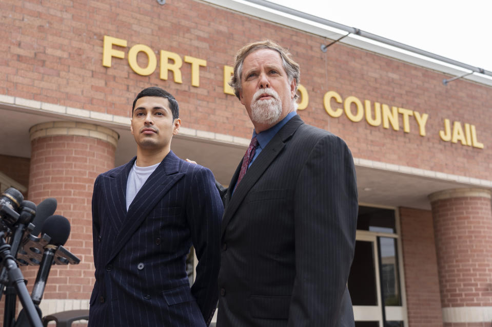 Victor Cuevas appears with his lawyer Michael Elliott after bonding out of jail, Wednesday, May 12, 2021, at the Fort Bend County Jail in Richmond, Texas. Cuevas was arrested Monday after fleeing a Houston Police Officer with a missing tiger in west Houston. Police said Monday that the tiger's whereabouts are not known. (Mark Mulligan/Houston Chronicle via AP)