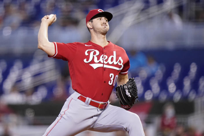 Cincinnati Reds starting pitcher Tyler Mahle throws during the first inning of a baseball game against the Miami Marlins, Sunday, Aug. 29, 2021, in Miami. (AP Photo/Lynne Sladky)