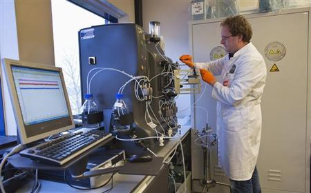 An operator installs a chromatography column to purify the gene therapy drug Glybera at Dutch biotech company uniQure in Amsterdam
