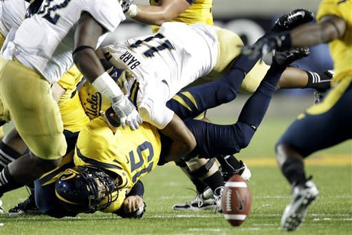 California quarterback Zach Maynard (15) fumbles the ball as he is sacked by UCLA linebacker Anthony Barr (11) during the first half of an NCAA college football game in Berkeley, Calif., Saturday, Oct. 6, 2012. California recovered the ball. (AP Photo/Tony Avelar)