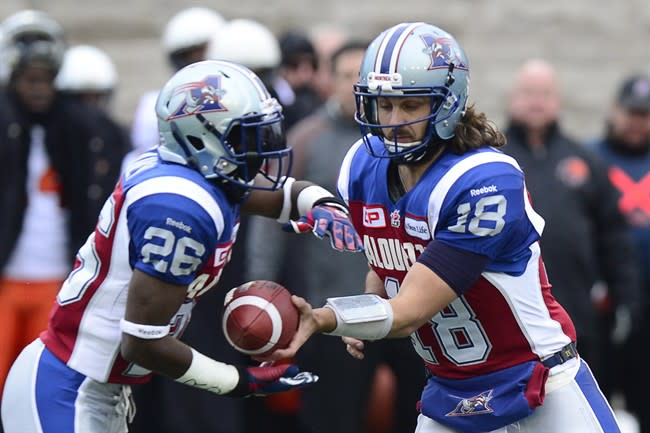 Montreal RB Chris Rainey (26. seen taking a handoff against B.C. Sunday) is one of at least four CFL players who have faced charges over allegations of domestic abuse. (Paul Chiasson/The Canadian Press.)