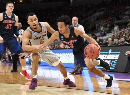 Mar 24, 2019; San Jose, CA, USA; Liberty Flames guard Darius McGhee (2) drives against Virginia Tech Hokies guard Justin Robinson (5) during the first half in the second round of the 2019 NCAA Tournament at SAP Center. Mandatory Credit: Kelley L Cox-USA TODAY Sports