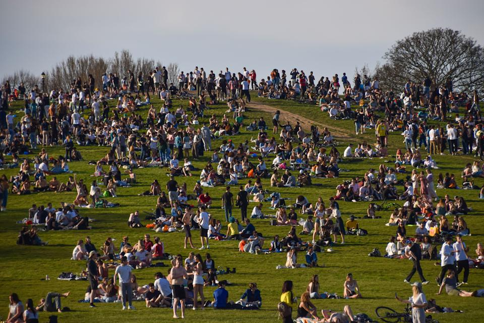 LONDON, UNITED KINGDOM - 2021/03/30: Crowds gather on Primrose Hill as a heatwave hits London.  Temperatures rise in the capital, prompting large crowds to gather in the parks around the city. (Photo by Vuk Valcic/SOPA Images/LightRocket via Getty Images)
