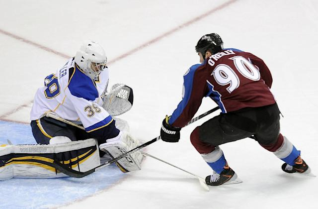 St. Louis Blues goalie Ryan Miller, left, stops a breakaway by Colorado Avalanche center Ryan O'Reilly, right, in the first period of an NHL hockey game on Saturday, March 8, 2014, in Denver. (AP Photo/Chris Schneider)