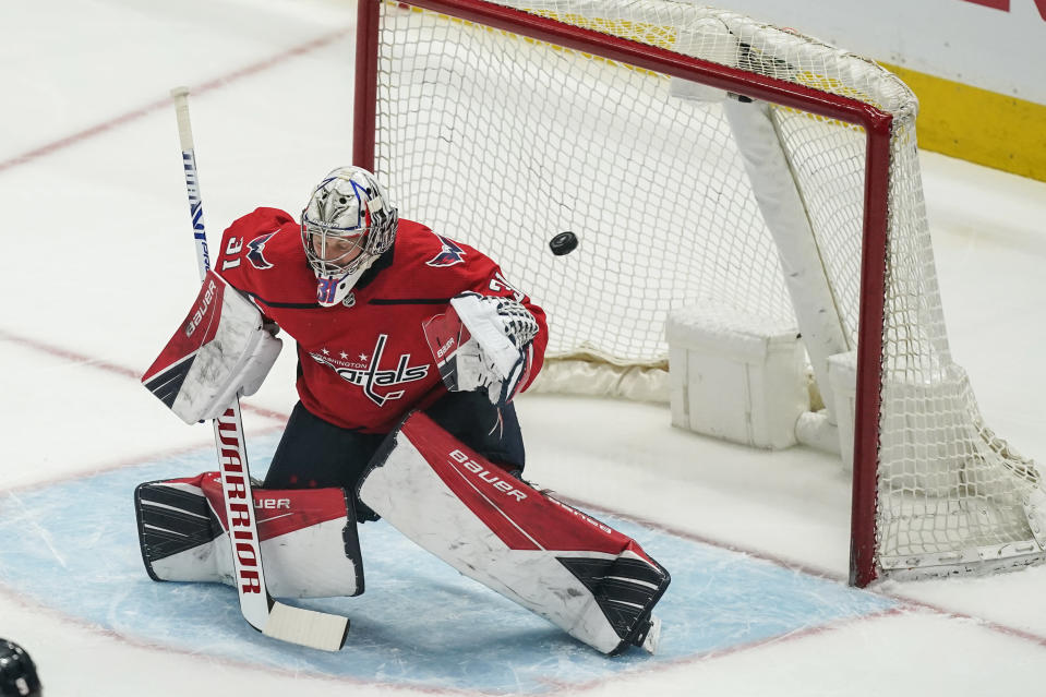 A goal by Boston Bruins center Patrice Bergeron gets past Washington Capitals goaltender Craig Anderson (31) during the first period of Game 2 of an NHL hockey Stanley Cup first-round playoff series Monday, May 17, 2021, in Washington. (AP Photo/Alex Brandon)