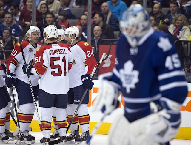 Florida Panthers left winger Sean Bergenheim (20) celebrates his goal with teammates Brad Boyes (24) and Brian Campbell (51) during the first period of an NHL hockey game against the Toronto Maple Leafs in Toronto on Thursday, Jan. 30, 2014. (AP Photo/The Canadian Press, Frank Gunn)