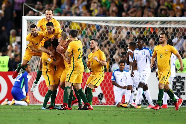 Australia 3 Honduras 1: Mile Jedinak the hat-trick hero fires the Socceroos to World Cup