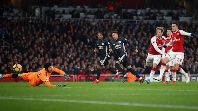 Jesse Lingard finishes the first of his two, and the second of Manchester United's three goals on Saturday at Arsenal. (Getty)
