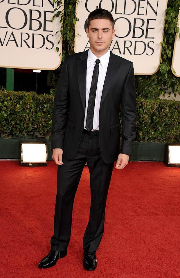 """<strong>Zac Efron:</strong> No one can pull of a classic black suit and skinny tie like Zac. How cute did he look at the Golden Globe Awards? (01/16/2011)<br><br><a target=""""_blank"""" href=""""http://www.seventeen.com/fashion/tips/worst-dressed-stars-2011?link=emb&dom=yah_omg&src=syn&con=slide&mag=svn"""">See the Worst-Dressed Stars of 2011</a><br><p class=""""MsoNormal""""><span style=""""text-decoration:underline;""""><span style=""""font-size:10pt;color:blue;font-family:'serif';""""><a href=""""http://www.seventeen.com/fashion/tips/worst-dressed-stars-2011?link=emb&dom=yah_omg&src=syn&con=slide&mag=svn""""><br></a></span></span></p>"""