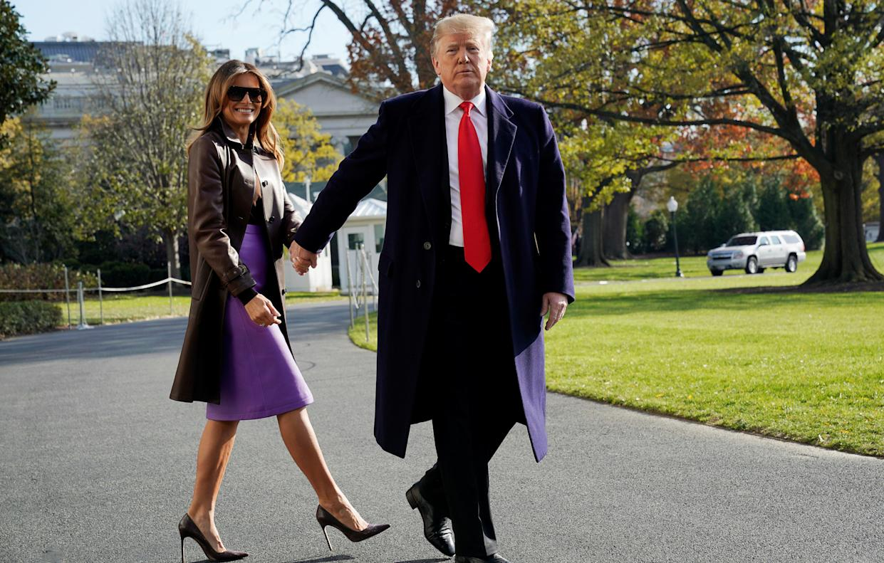 President Trump walks with first lady Melania Trump as they depart the White House on Thursday. (Photo: Jonathan Ernst/Reuters)