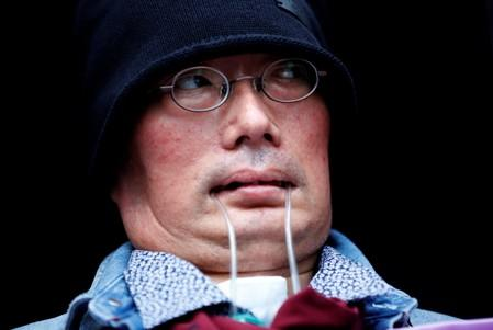 Reiwa Shinsengumi's cadidate for Japan's July 21 upper house election, who has ALS, attends an election rally in Tokyo