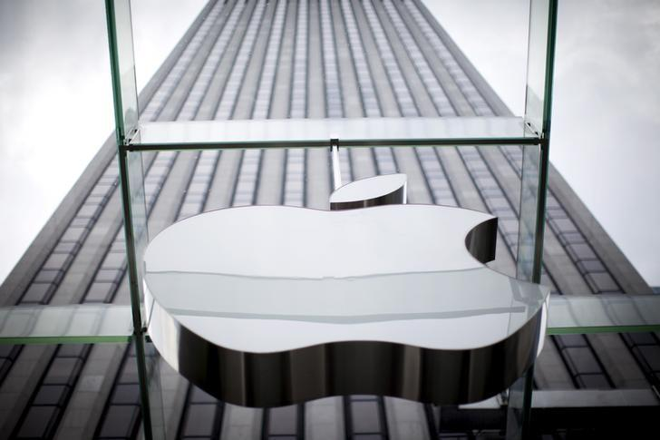 FILE PHOTO - An Apple logo hangs above the entrance to the Apple store on 5th Avenue in the Manhattan borough of New York City