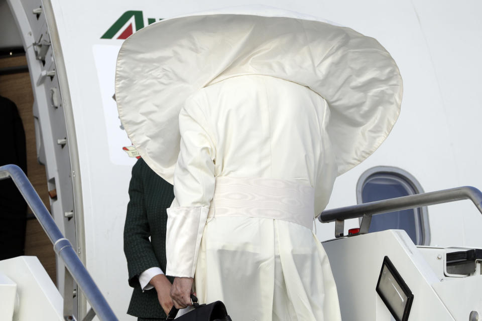 A gust of wind blows Pope Francis' cape as he boards an airplane at Rome's Fiumicino international airport, Saturday, Aug. 25, 2018. The pontiff is traveling to Ireland for a two-day visit on the occasion of the 2018 World Meeting of Families. (AP Photo/Andrew Medichini)